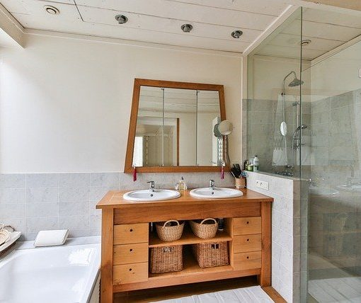 dual sink bathroom with tub and shower