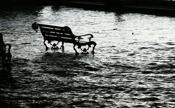 park bench in flood waters
