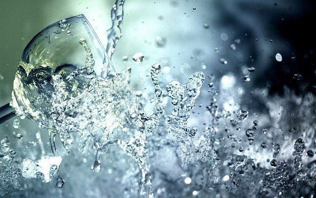 water splashing on wine glass