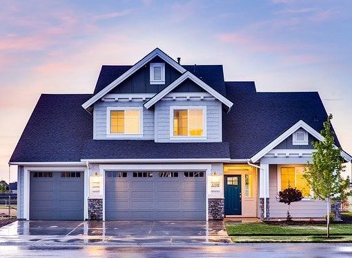 grey blue house with three car garage